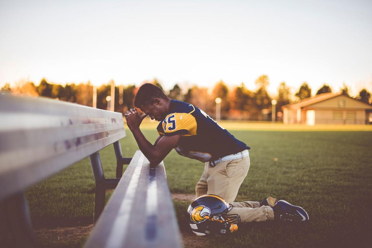 President Trump has criticized NFL players as unpatriotic for kneeling during the national anthem, a gesture which supporters say brings awareness to racial injustice.  Courtesy of Unsplash.com