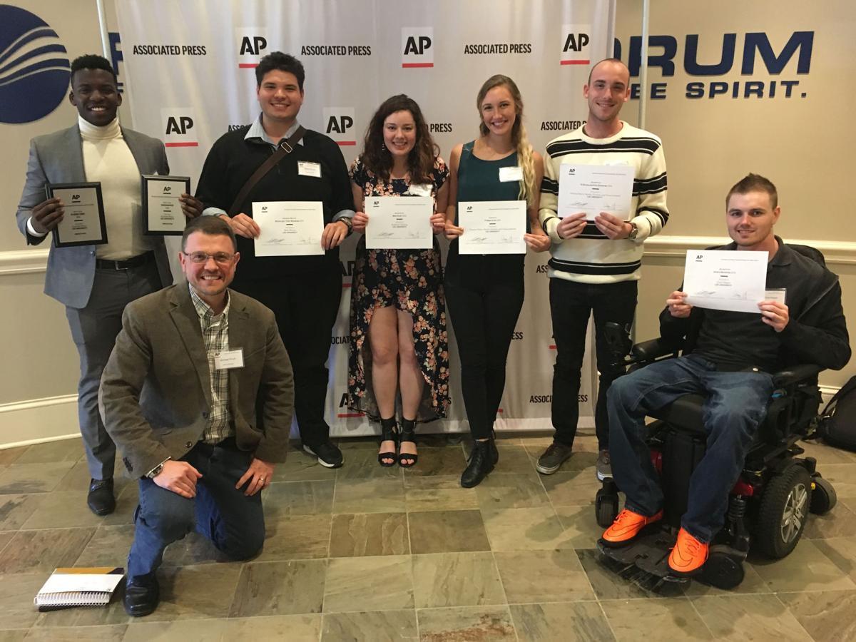 Lee Student Media members hold their awards in Nashville, TN on Saturday, April 8. Left to right: Dumisa Moyo, Michael Finch, Blake Bouza, Kimberly Sebring, Alex Farmer, Evan Pell and Chad Magee.  Photo courtesy of Kimberly Sebring