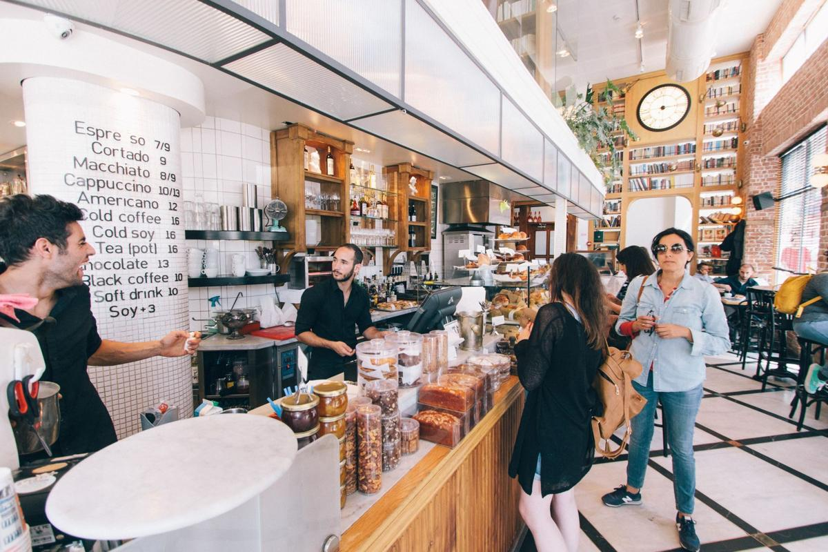 Israelis place coffee orders and mingle in a cafe in Tel-Aviv.  Courtesy of Rob Bye