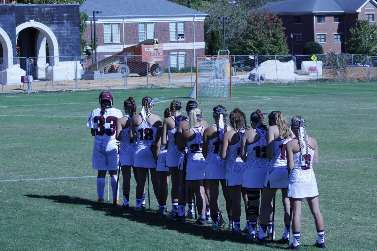 Lady Flames Lacrosse Team Line up For National Anthem  taken by Alex Farmer