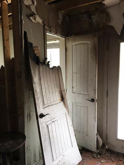 The door to the balcony off the front bedroom where the fire started.
