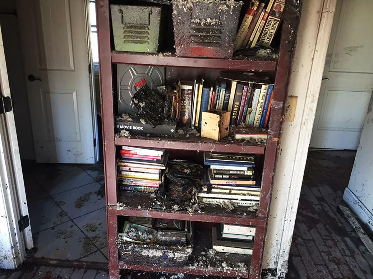 One bookshelf in the front bedroom after the fire. The other bookshelf that held McCampbell's Douglas Coupland books was disintegrated.