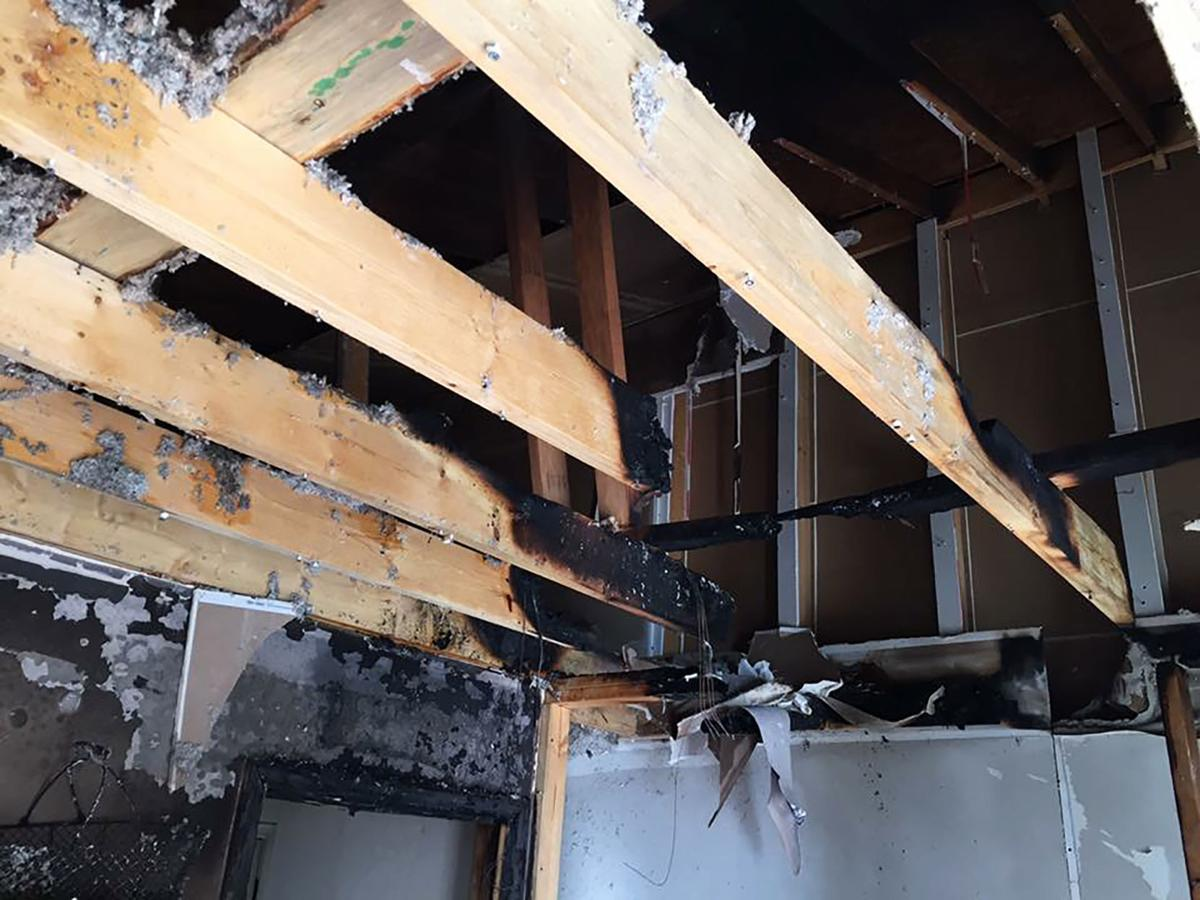 The attic can be seen from this photo of the ceiling in the room where the fire started.