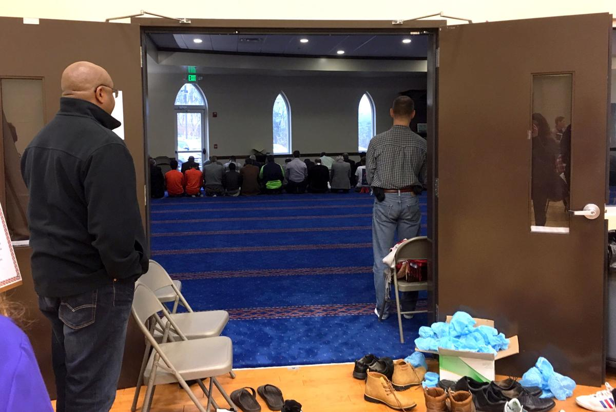 Bystanders observe a Muslim prayer service at the ISGC.  Photo by Kimberly Sebring, News Editor