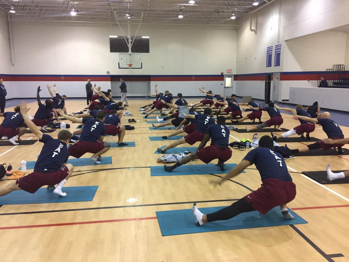 The baseball team does a yoga workout in the gym at the DeVos Rec Center.  Taken by Coach Mark Brew