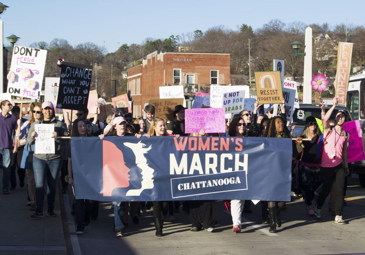 Protestors march on Market Street Bridge in Chattanooga, Tennessee on Saturday, Jan. 21.  Photo by Kimberly Sebring