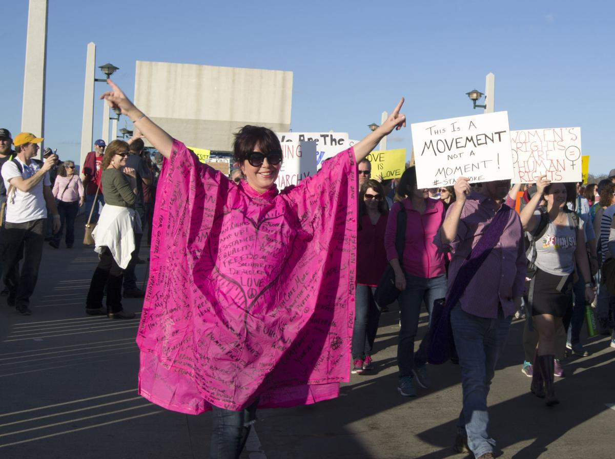 A protestor demonstrates her support for women's rights on Market Street Bridge in Chattanooga on Saturday, Jan. 21.  Photo by Kimberly Sebring