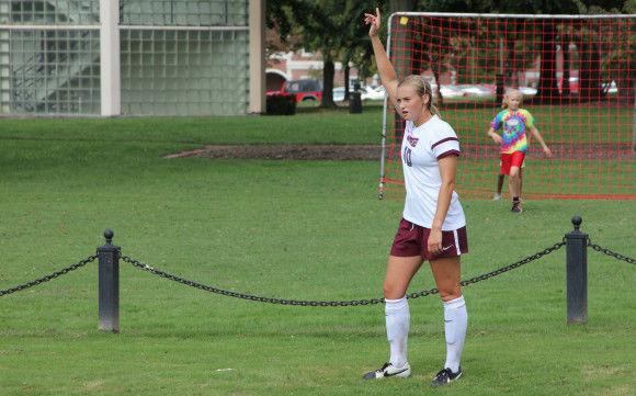 McKenzie Bricker takes aim for a corner kickPhoto by Sam Anderson