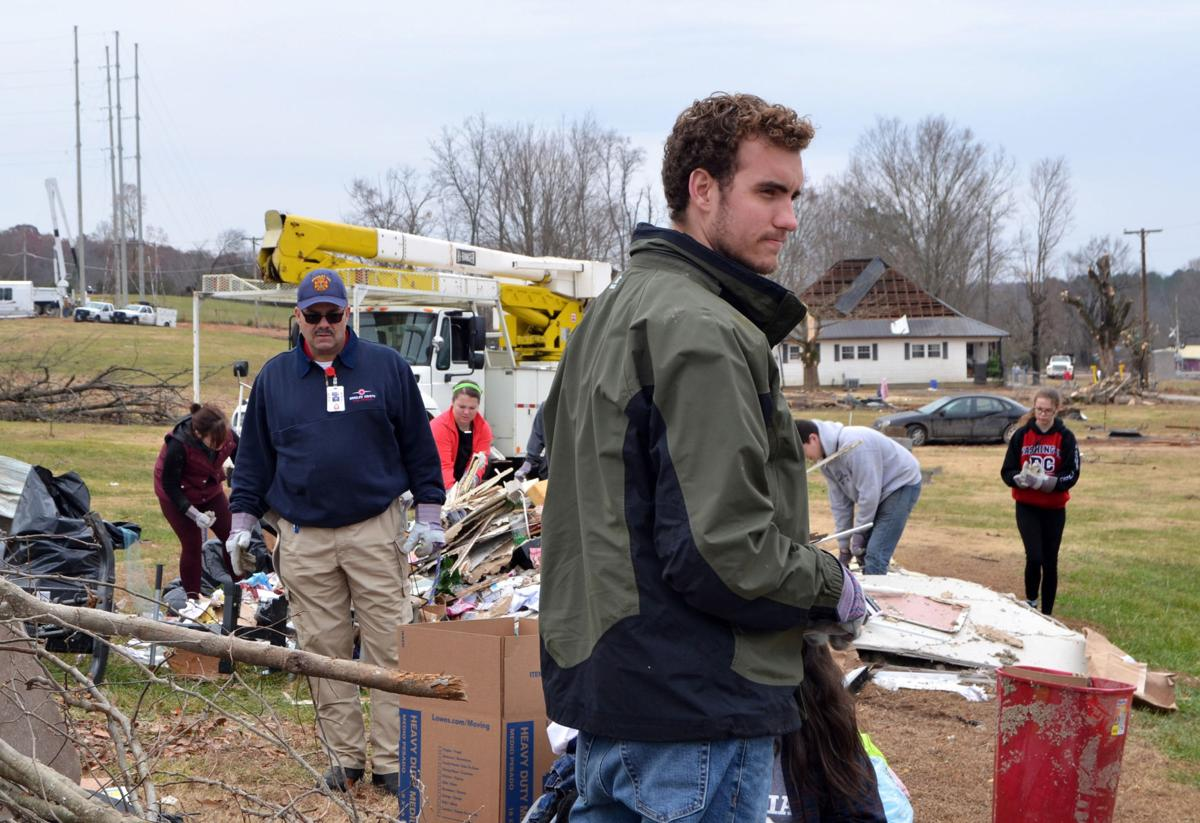 Tatum McKinnon (front) helps clean up tornado damage alongside fellow students and Campus Pastor Jimmy Harper (left) in Polk County, TN on Saturday, Dec. 3.  Photos by Kimberly Sebring