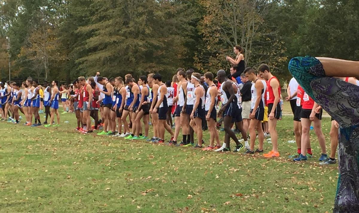 The men's Cross Country team lines up before a race.  Photo by Alex Farmer