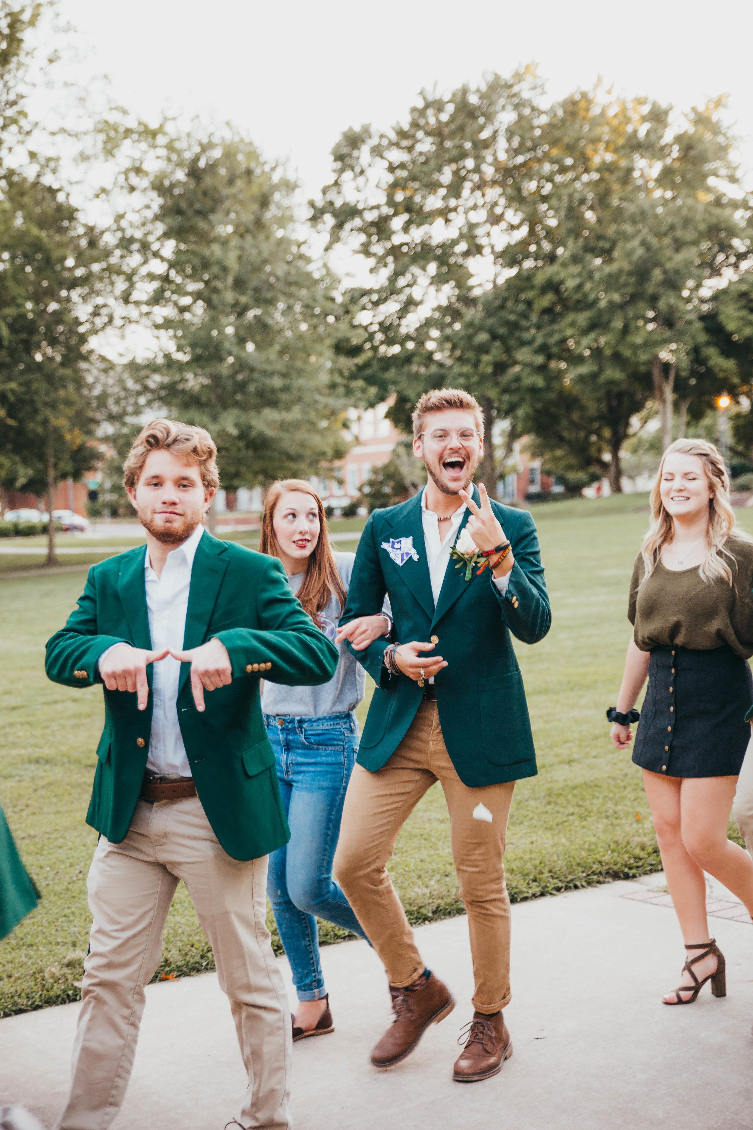 Pi Kappa Pi members during their walk through campus on Tap Night.