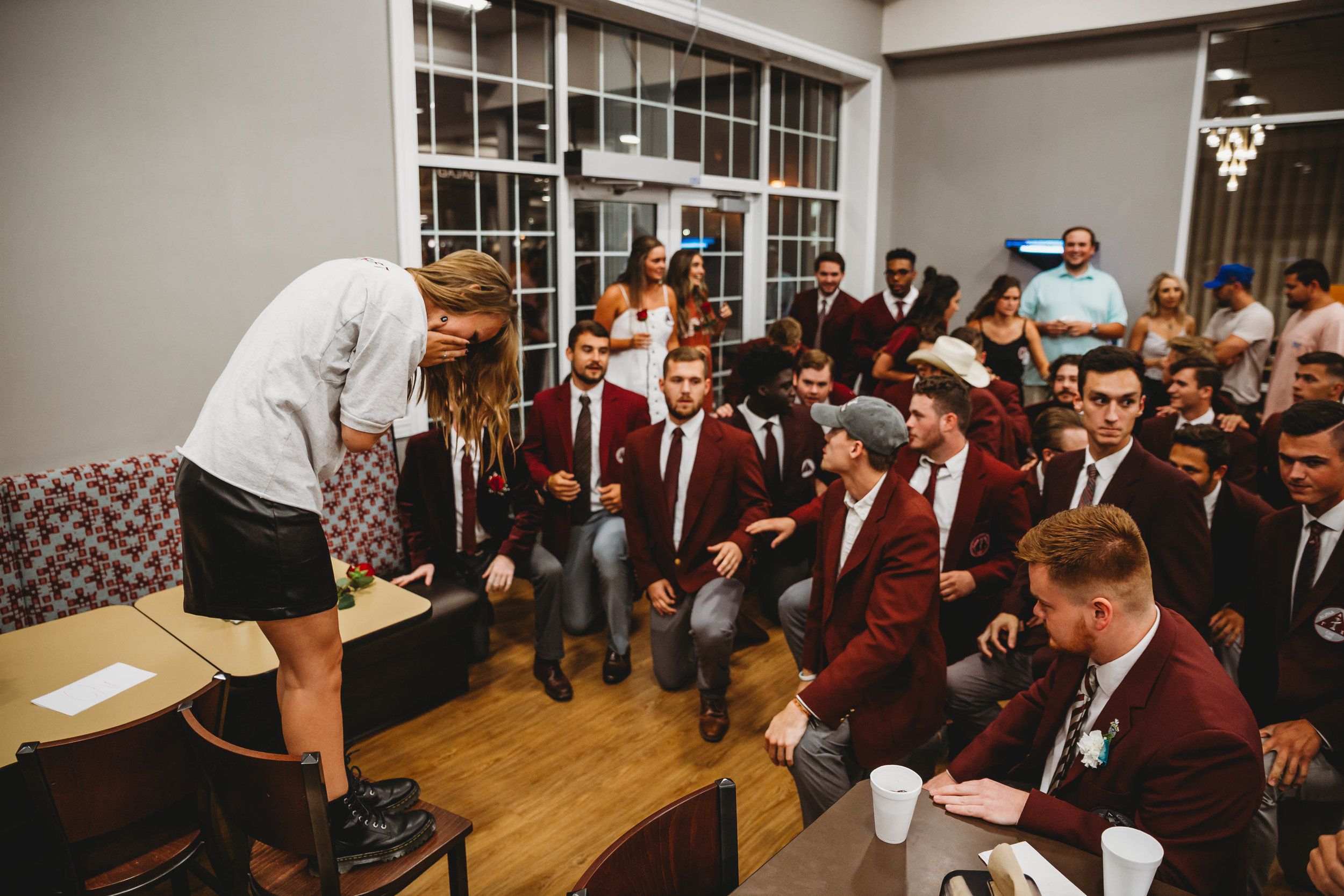 Alpha Gamma Chi members kneel for their new sweetheart.