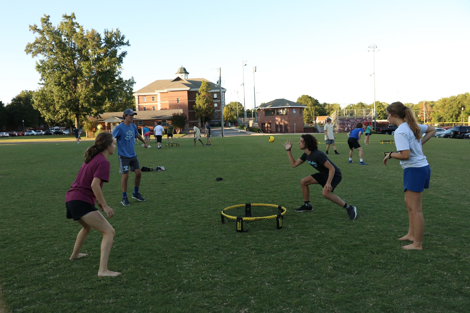Students playing Spikeball at Storms Field.