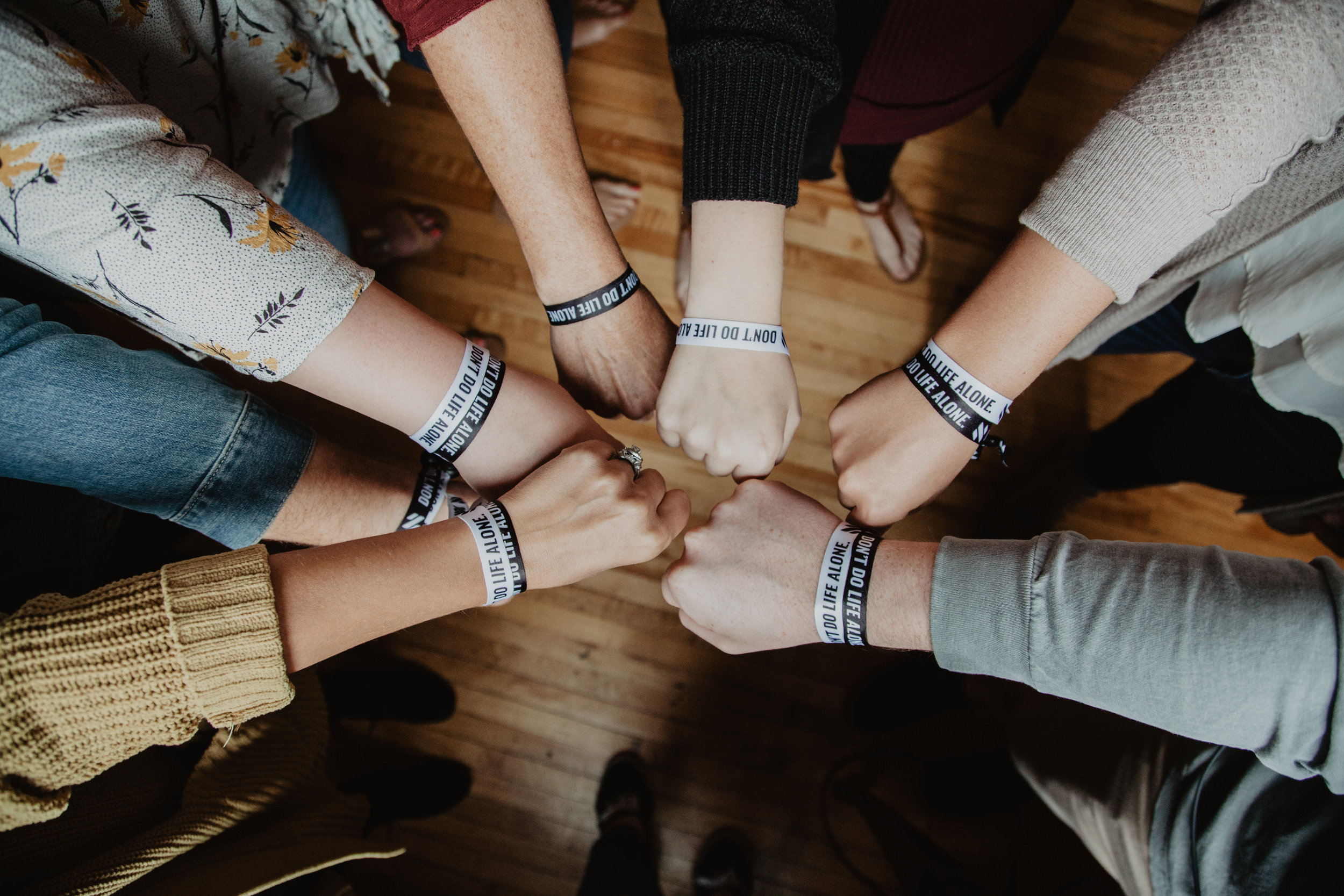 """Neo Church members sporting the """"Don't do life alone"""" bracelets."""