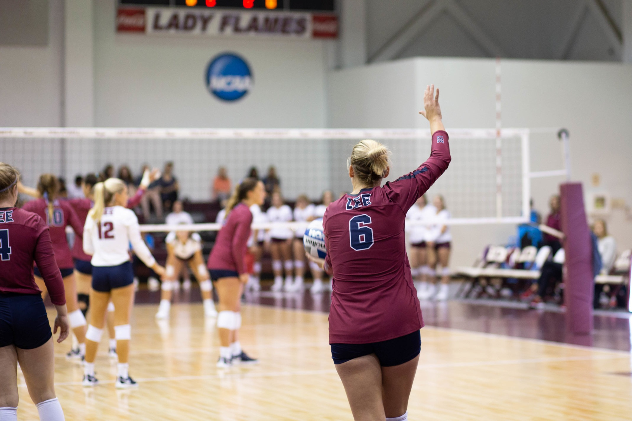 Matthews prepares to serve for the Lady Flames
