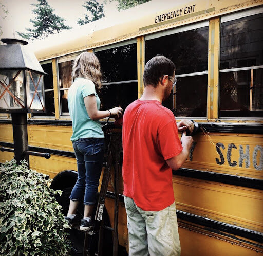 Brian and his daughter, working on the outside of the bus. Photo courtesy of Serenity Bus Project Instagram.
