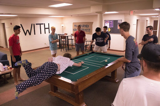 """Residents of BOB regularly play a game called """"spud"""" with pool balls. Photo by Matthew Taylor."""