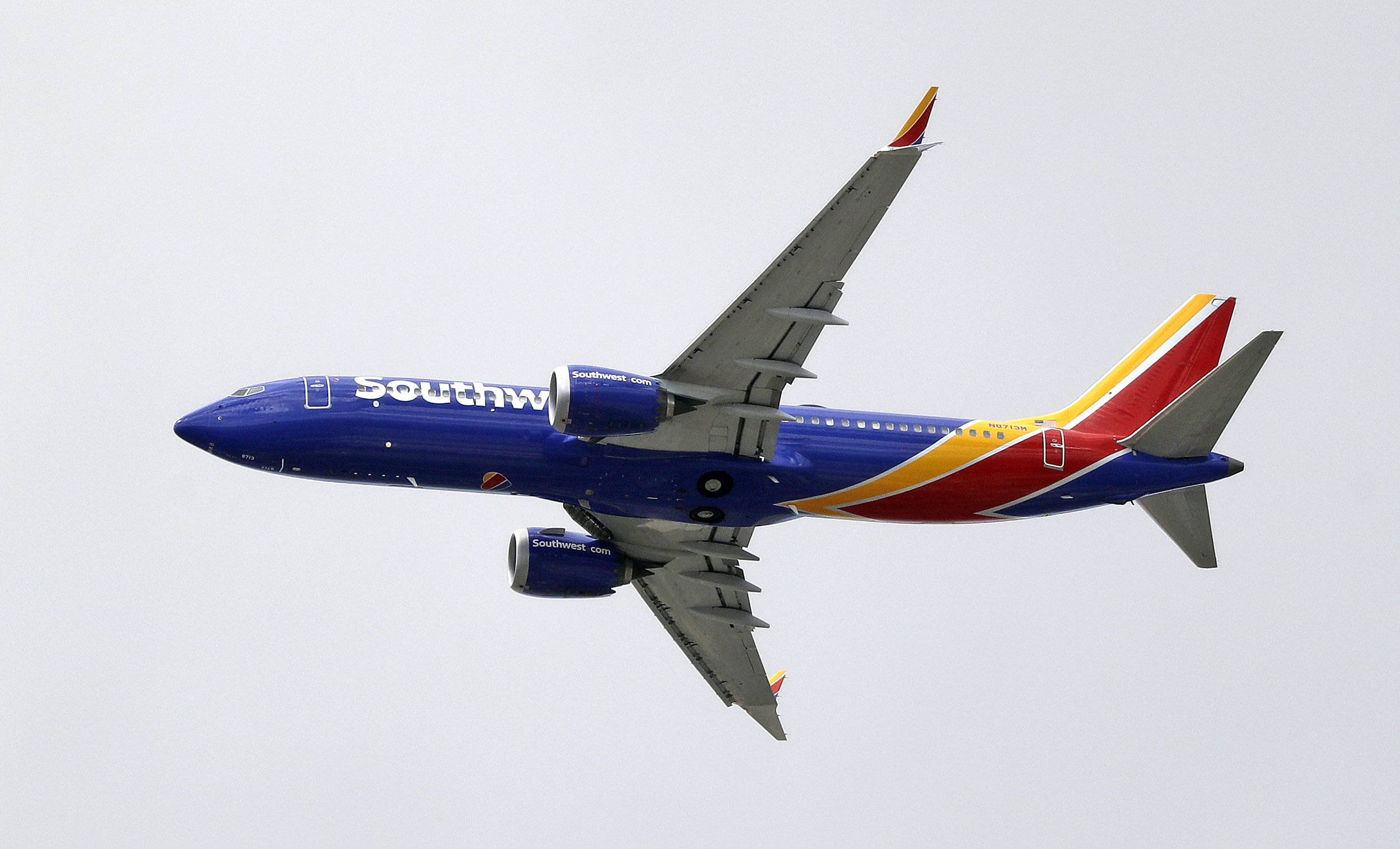 FILE - On this Wednesday, March 13, 2019, file photo, a Southwest Airlines Boeing 737 Max 8 jet flies over Mesa, Ariz., en route to Phoenix's Sky Harbor International Airport. Pilot-union leaders at Southwest Airlines say it could be February or March 2020 before their airline resumes flights using the Boeing 737 Max. (AP Photo/Elaine Thompson, File)