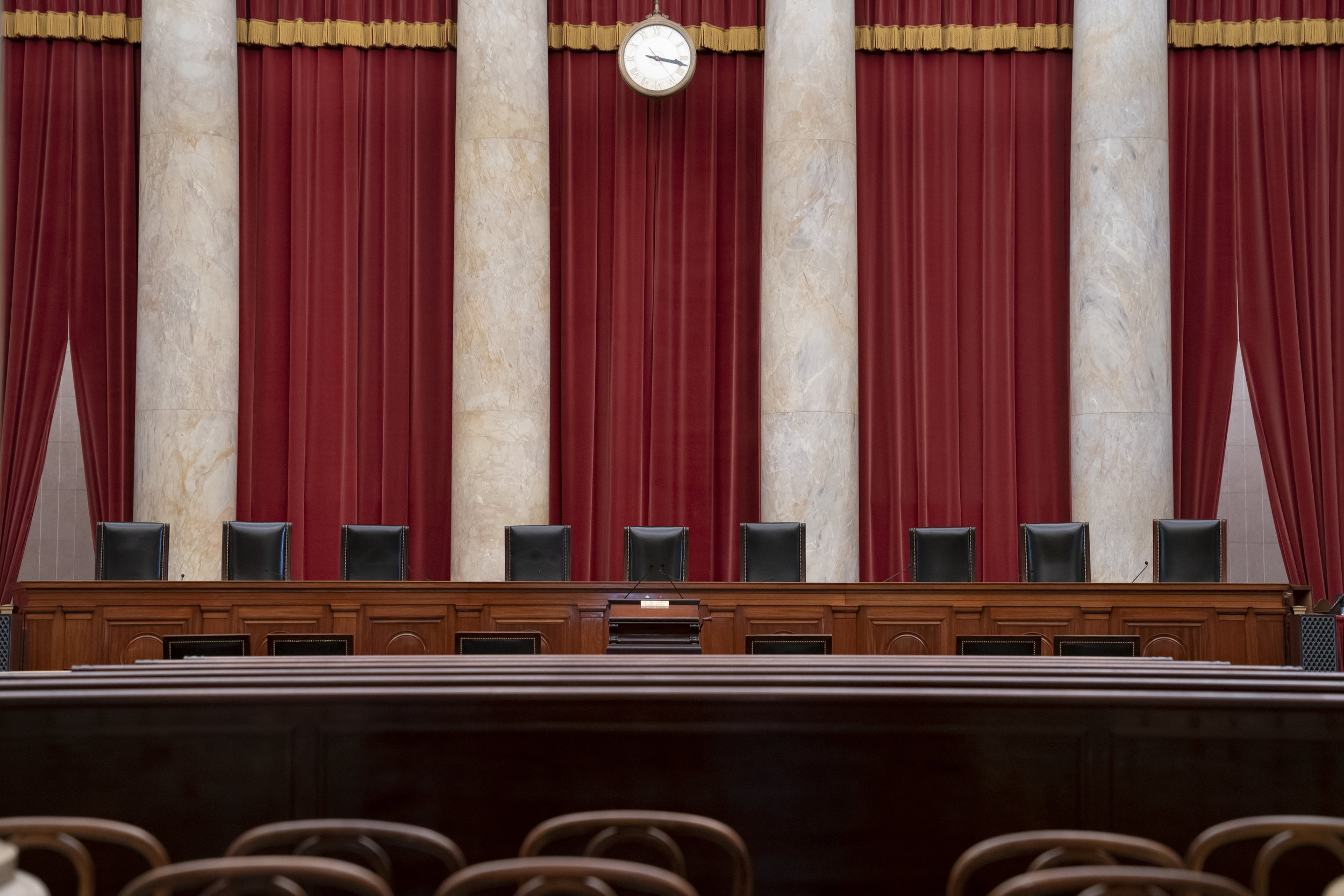 In this June 24, 2019 file photo, the empty courtroom is seen at the U.S. Supreme Court in Washington. (AP Photo/J. Scott Applewhite)