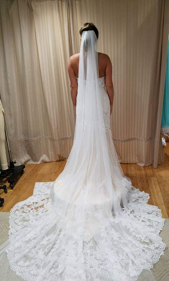 Final fitting at studio - we removed the beautiful scalloped lace at the hemline & reattached after it was shortened; the bodice was taken in.  Custom cathedral veil