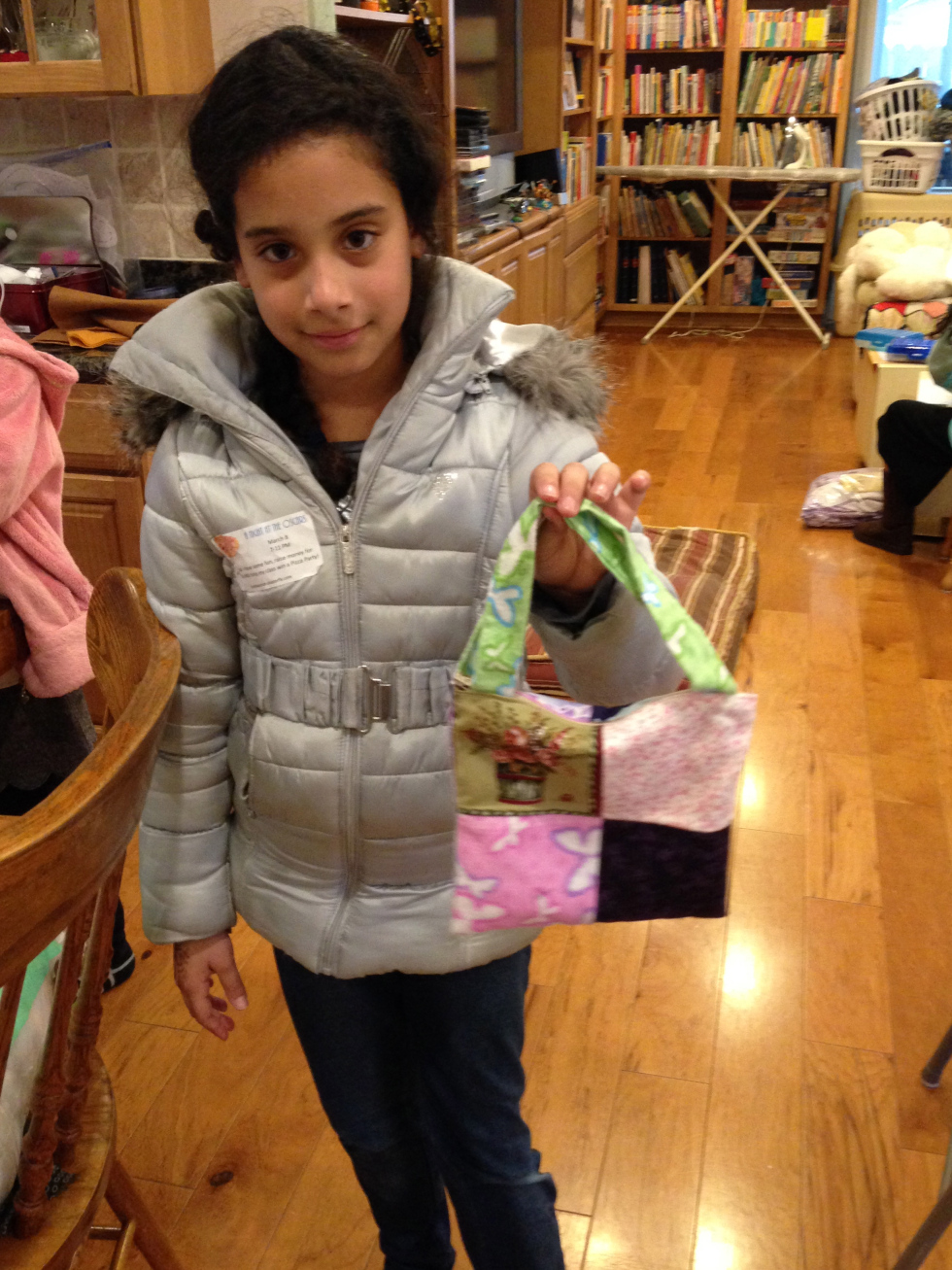 Completely lined purse with a zippered closure by a 3rd grader.