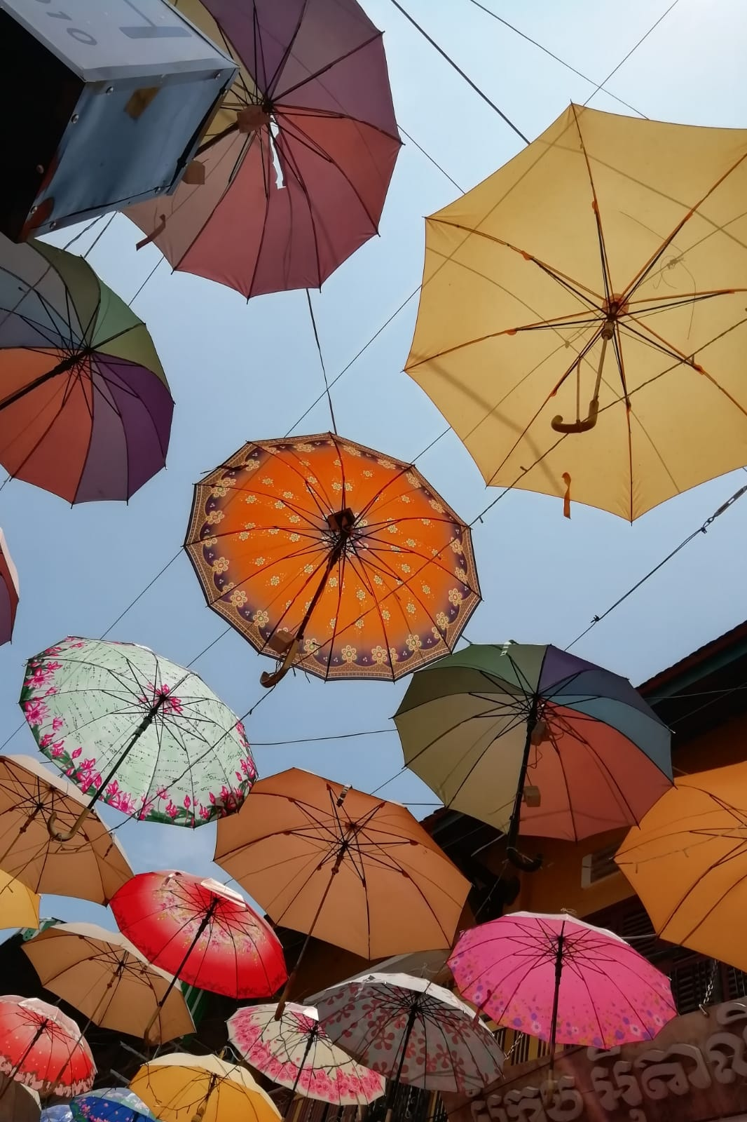 Umbrellas in the sun. Outside the great fair fashion store Blush Boutique in Siem Reap.