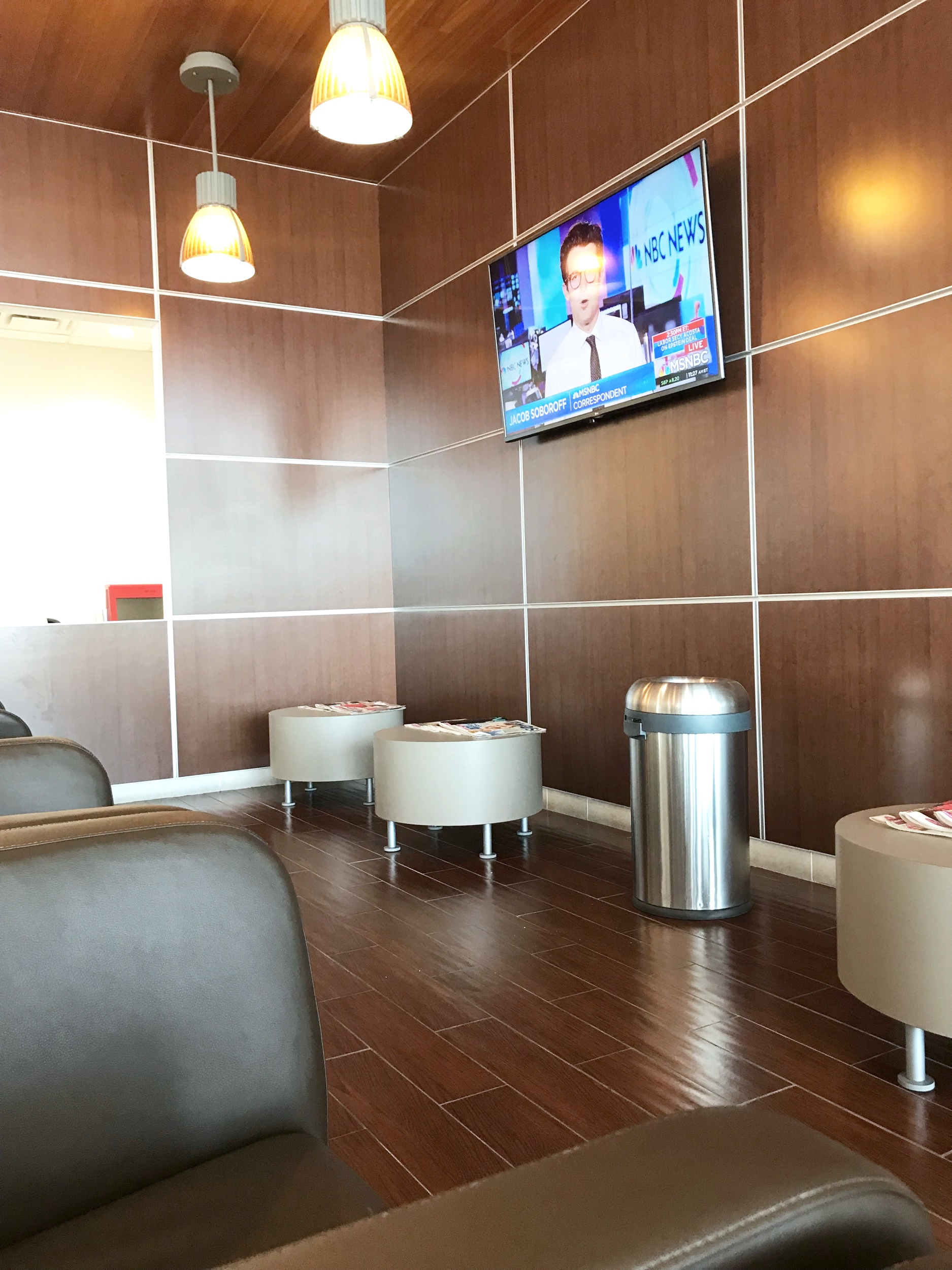 The waiting area of the local dealership's service department.