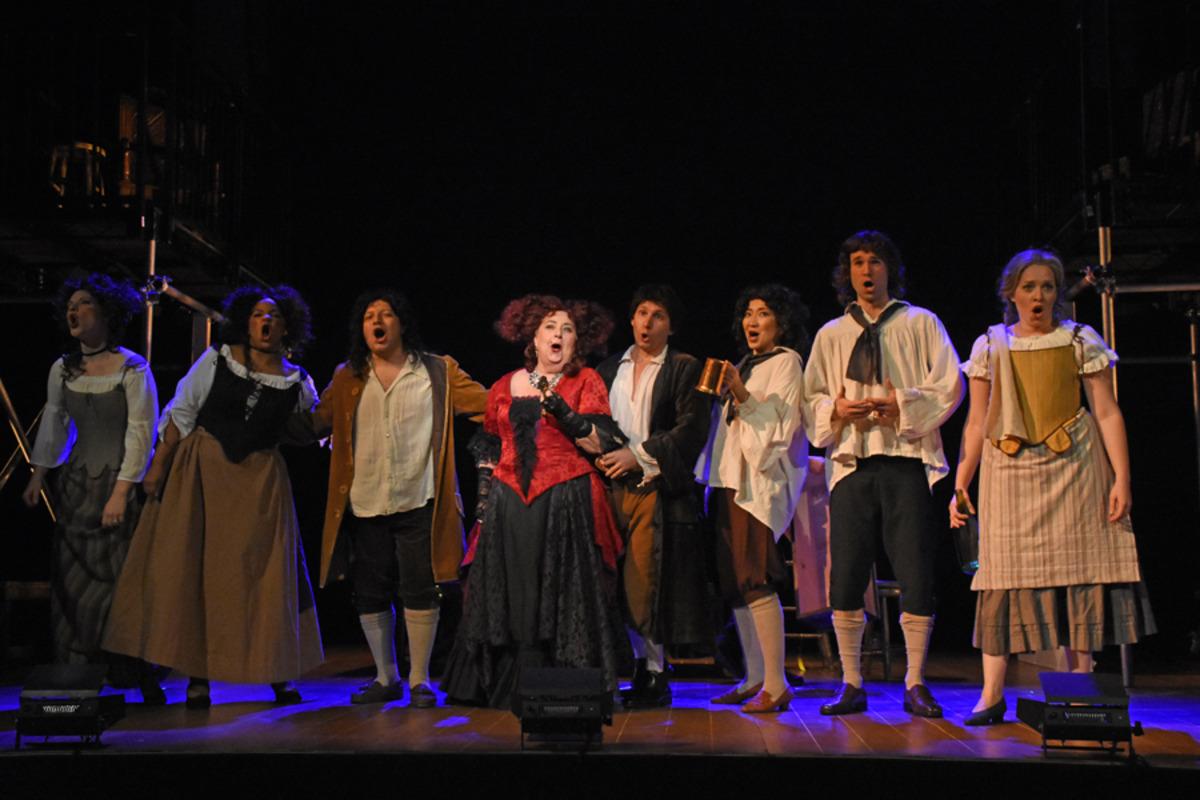 Mistress Revels (J. Shaulis) and revelers at the tavern - Photo by Tina Buckman