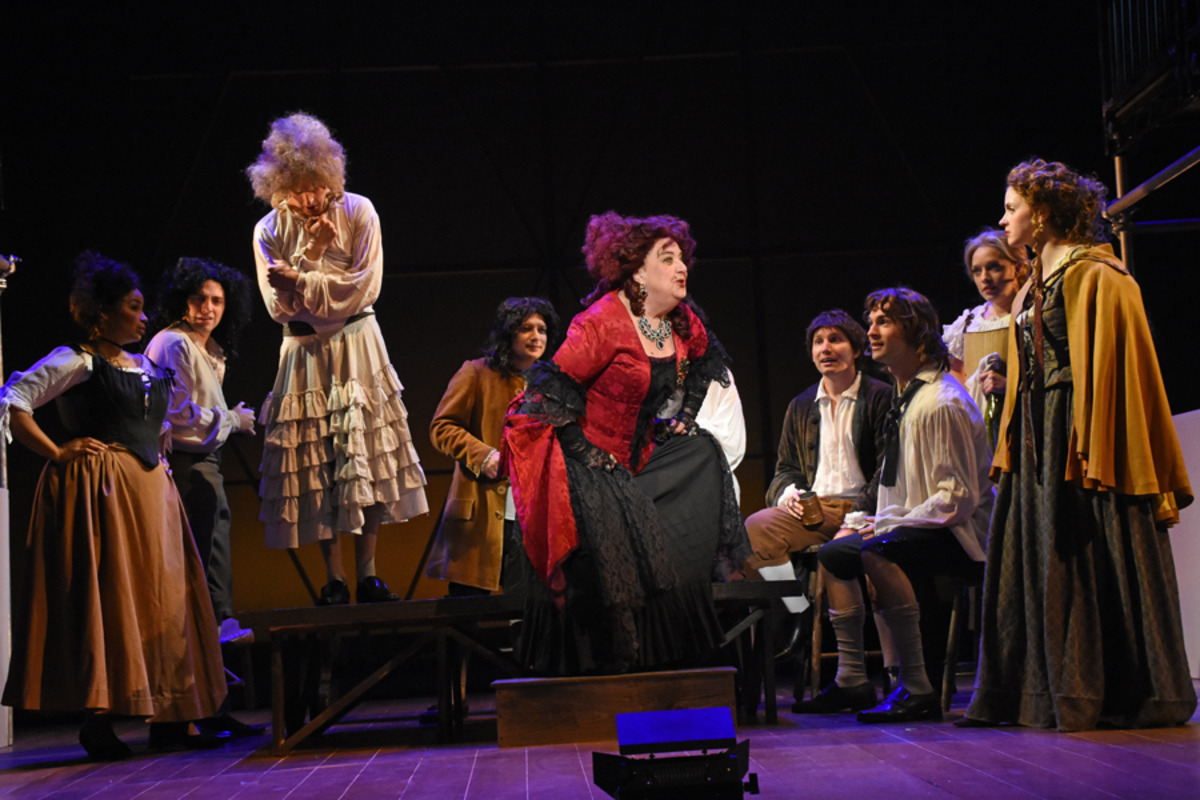 Mistress Revels (J. Shaulis) confronts Margaret Hughes (M. Höglund) at the tavern as revelers look on - Photo by Tina Buckman