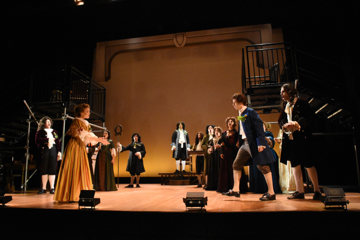 Margaret (J. Sandidge), Kynaston (S. Owens), Villiers (J. Kaneklides) in foreground while palace court looks on - Photo by Tina Buckman