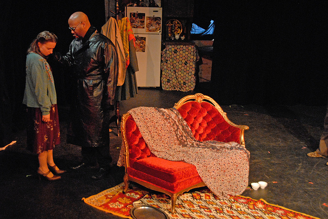 Irina (Gabrielsen) & Man in Black Coat (Grier) - Photo by Tina Buckman