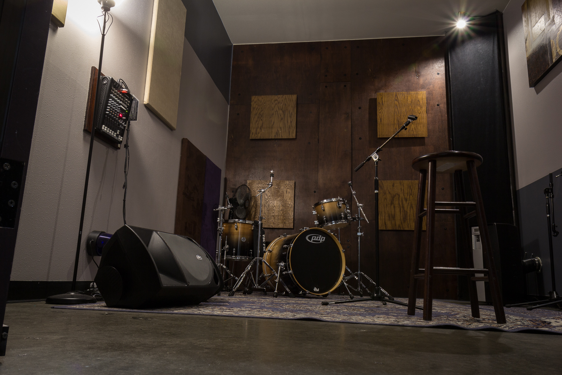 3-Piece Studio - Will accommodate 3 people with equipment nicely. Based on the Fibonacci sequence, it aims for a flat eq response and is treated for a good amount of ambiance. The dimensions are 10x16x11. It is a fantastic tracking room. As an option, it comes with an all birch DW PDP Concept drum kit. $13 per hour.