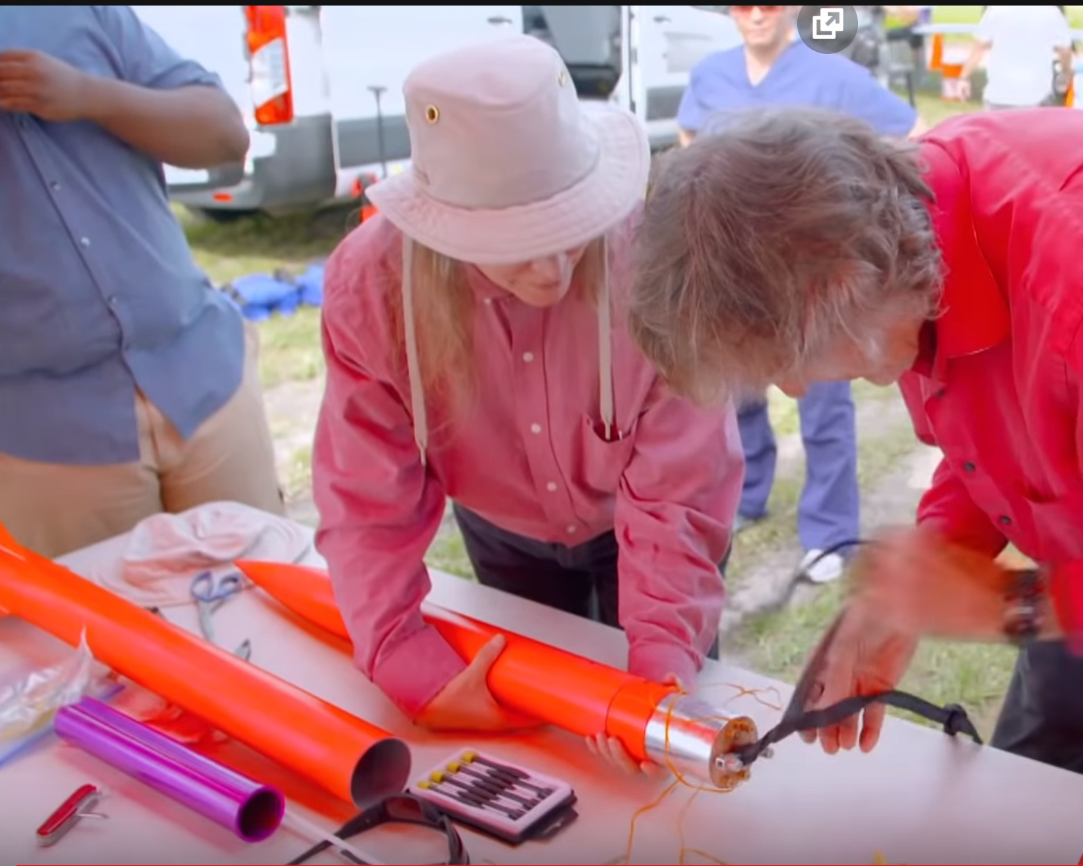 Inserting electronics into rocket - Courtesy of the Discovery Channel