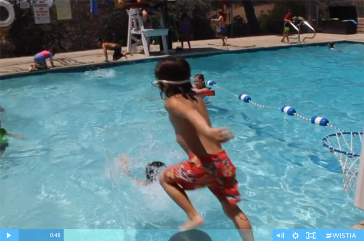 This little boy also runs and jumps off the pool deck into three feet of water and lands inches from another boy.