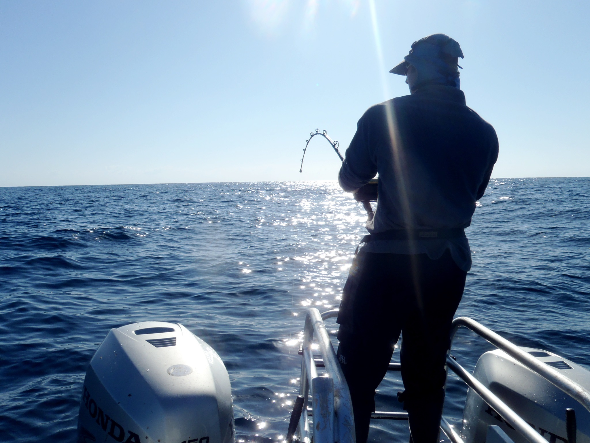 TTD - Fishing guy with line out off boat JR.jpg