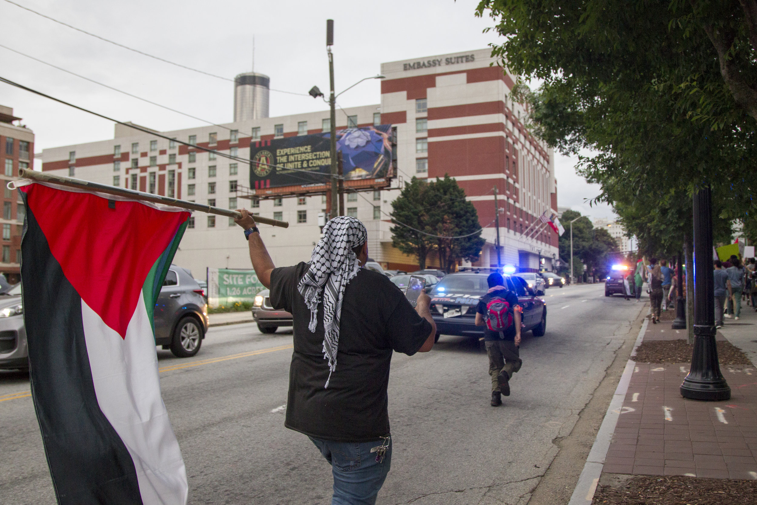Protestors take to the streets at the emergency protest for the violence in Gaza in Downtown Atlanta, Georgia, on Tuesday, May 15, 2018.