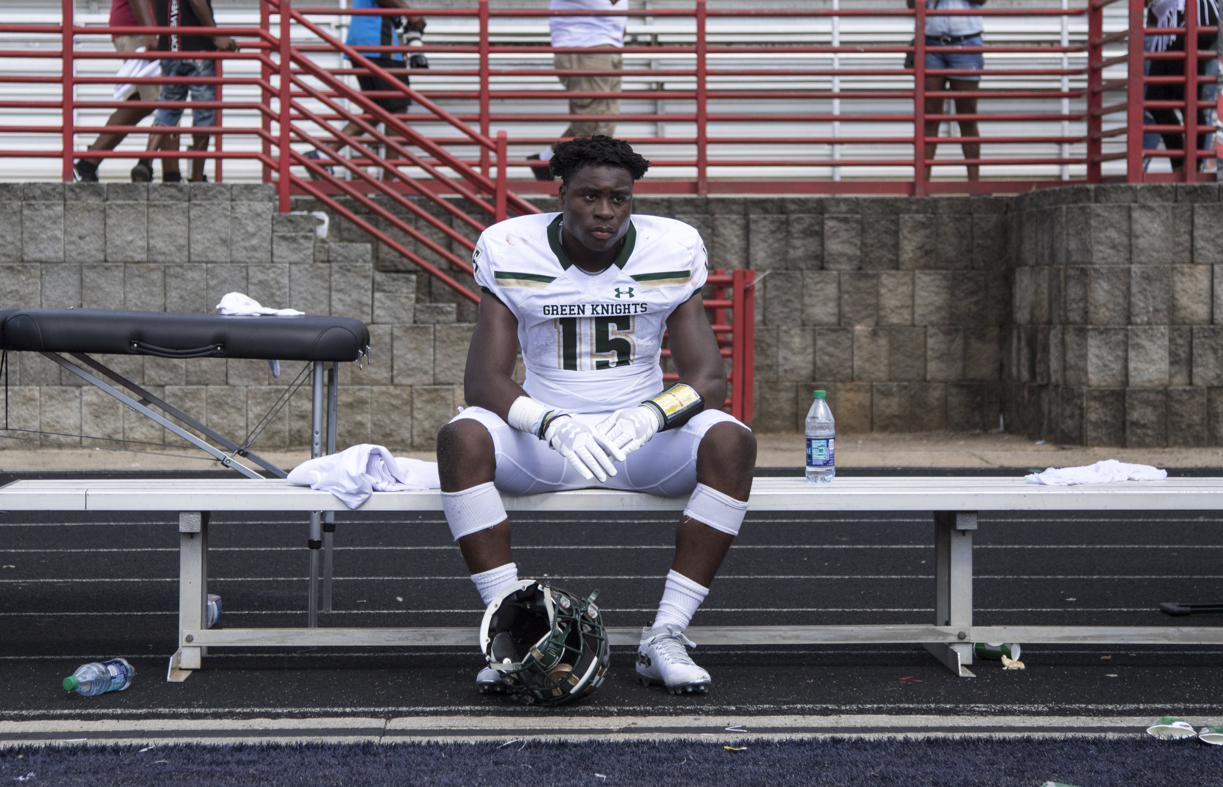 Audric Estime (15) of St. Joseph Regional sits on the bench after the end of the second half of the football game between the St. Joseph Regional Green Knights and the American Heritage Patriots during the Liberty Bowl at Milton High School in Milton, GA on Saturday, September 1, 2018. The Green Knights fell to the Patriots 17-20.