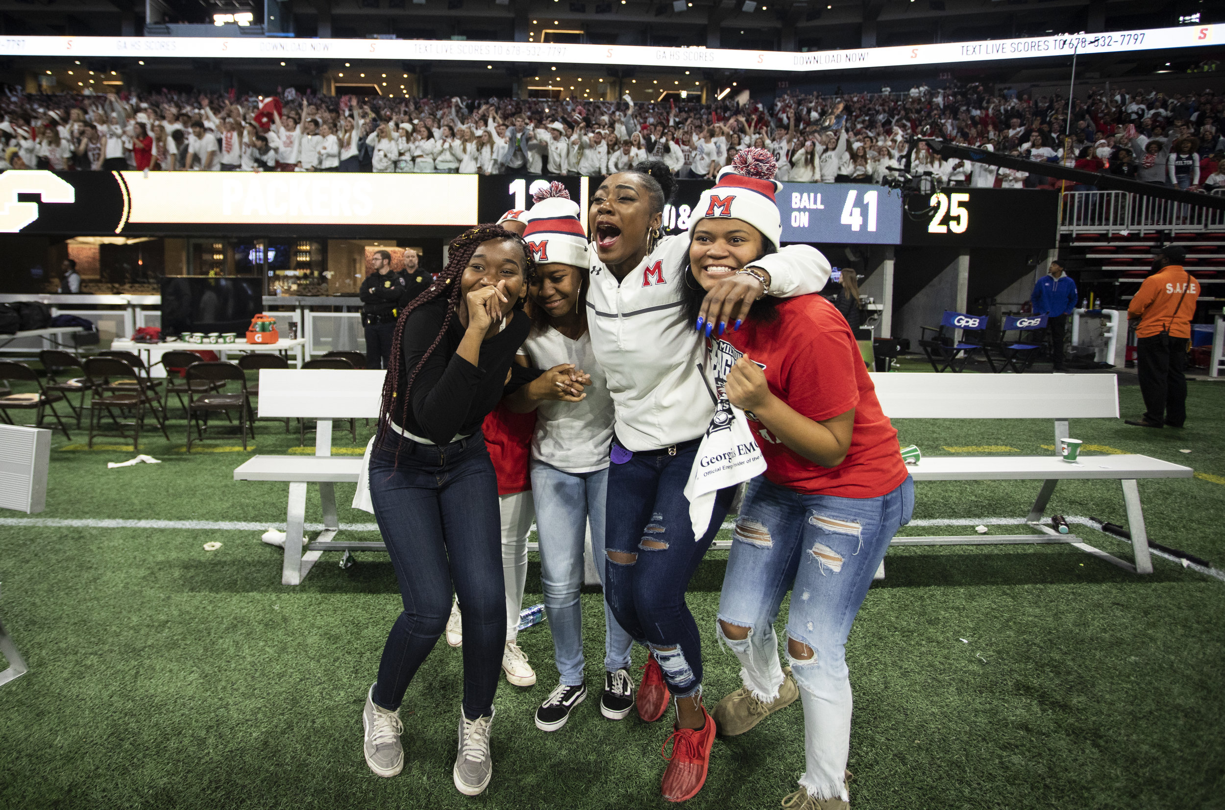 Milton High students are overwhelmed with excitement as time expires during the GHSA 7A State Championship game between the Milton Eagles and the Colquitt County Packers at Mercedes-Benz Stadium in Atlanta, Georgia, on Wednesday, December 12, 2018. The Eagles took down the Packers 14-13 to claim their first state championship title.