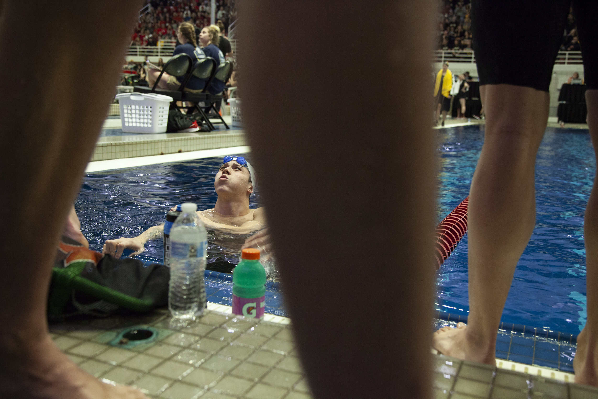 A member of the Tennessee Men's Swimming & Diving Team reacts to their teammates' times after a relay on the final day of competition at the Swimming & Diving SEC Championship at Gabrielson Natatorium in Athens, Georgia, on Saturday, February 23, 2019.