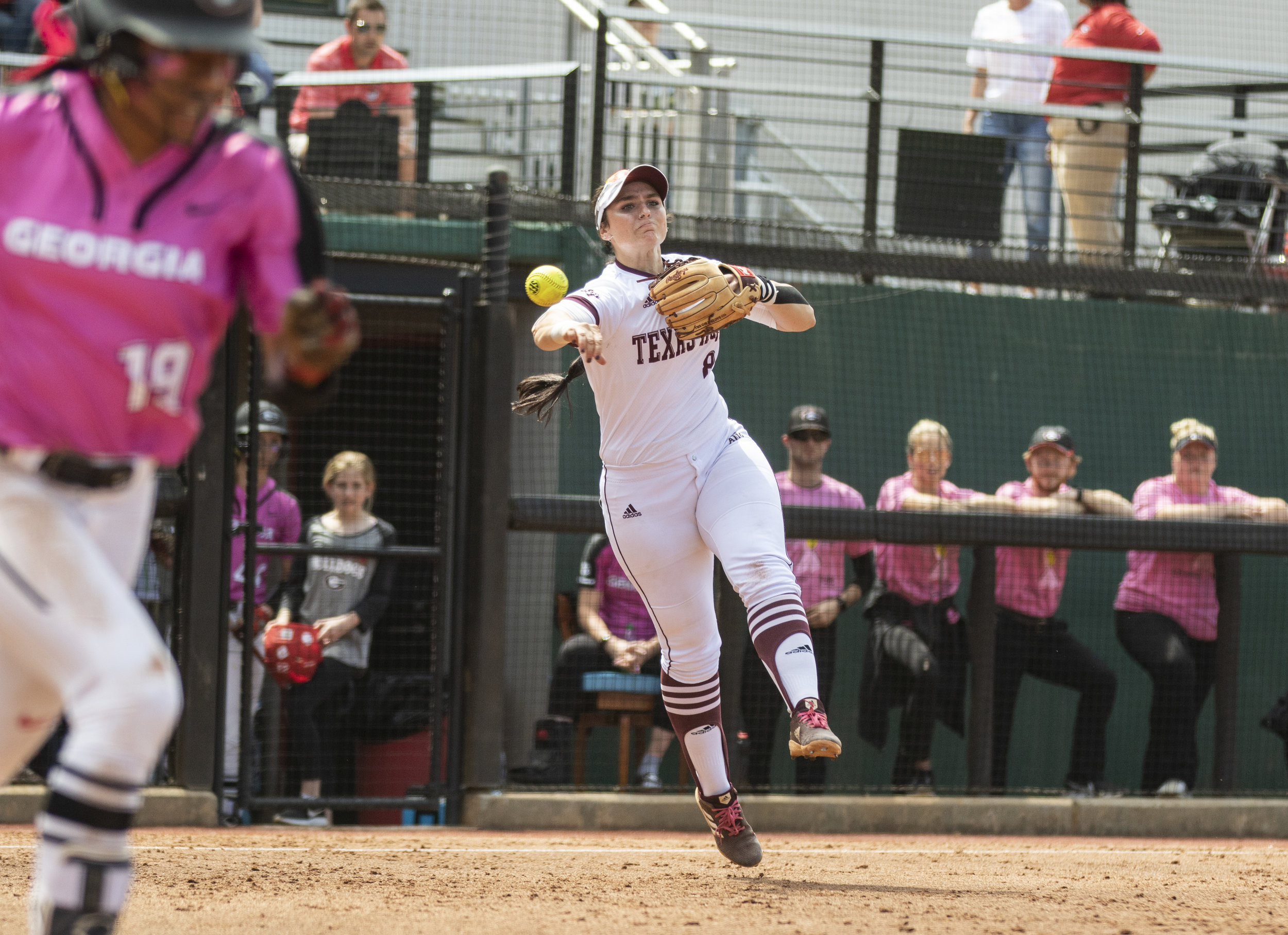 Texas A&M third baseman Baylee Klinger (8) throws the ball to first to get Georgia outfielder CJ Landrum (19) during the regular season game between the Texas A&M Aggies and the Georgia Bulldogs at Jack Turner Stadium in Athens, Georgia, on Saturday, April 6, 2019.