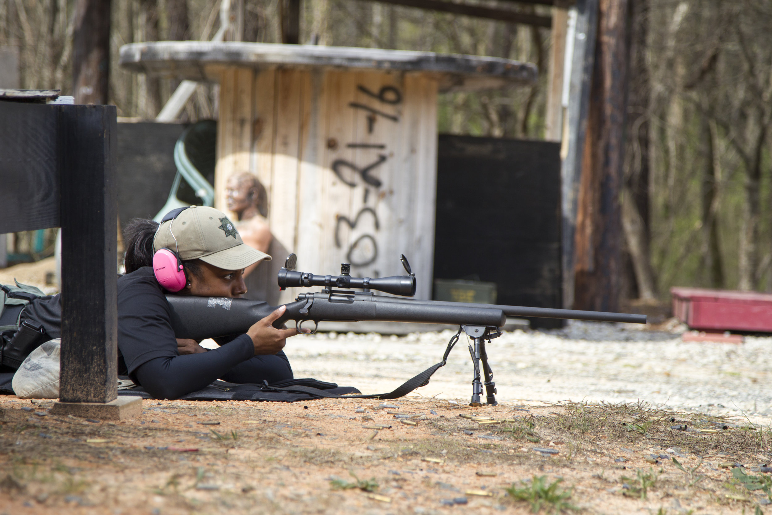 LaShira Norwood, 31, a Fulton County deputy, prepares to fire a Remington 700 sniper rifle at the David L. Hagins Firing Range in Atlanta, Georgia, on Monday, April 2, 2018. Norwood is Fulton County Sheriff Office's first female sniper.