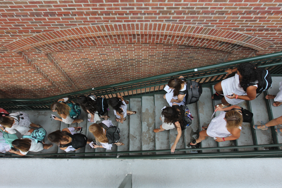 New sorority members walk down the stairs next to the Miller Learning Center on The University of Georgia campus to head to their houses during Fall 2017 Sorority Bid Day in Athens, Georgia, on Monday, August 14, 2017. The week long recruitment concludes with the new members celebrating at their respective sorority houses with their new sisters.