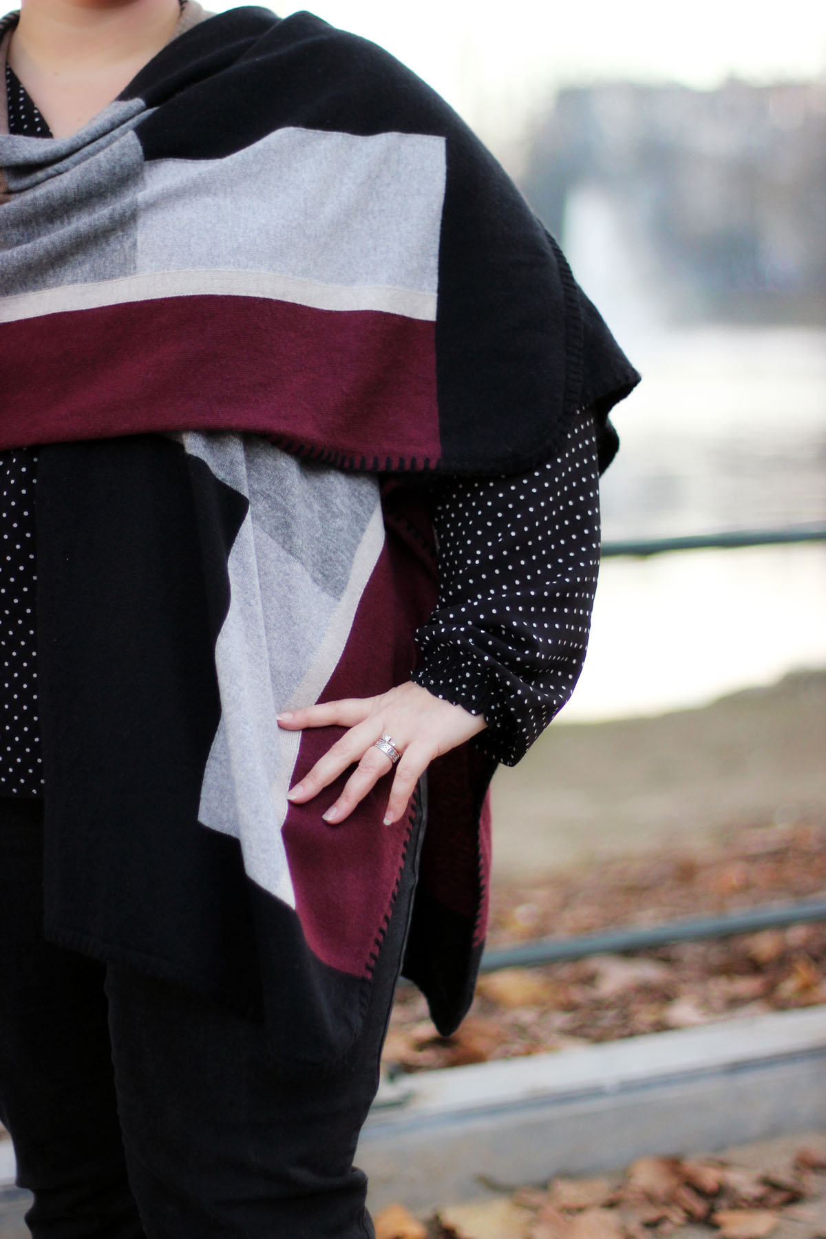 Close up of Sheila's aubergine, white and black shawl.