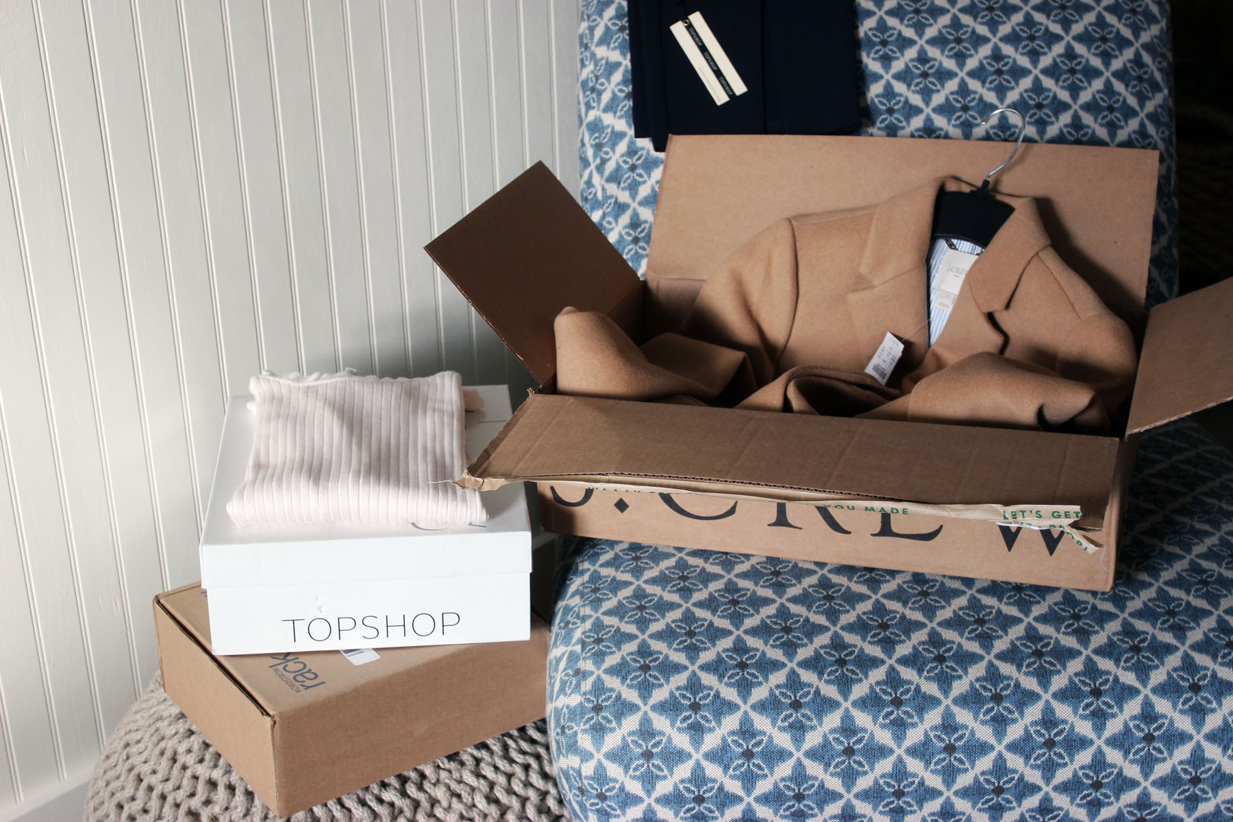 Unboxing favorite pieces of clothing after a stress-free online shopping experience.