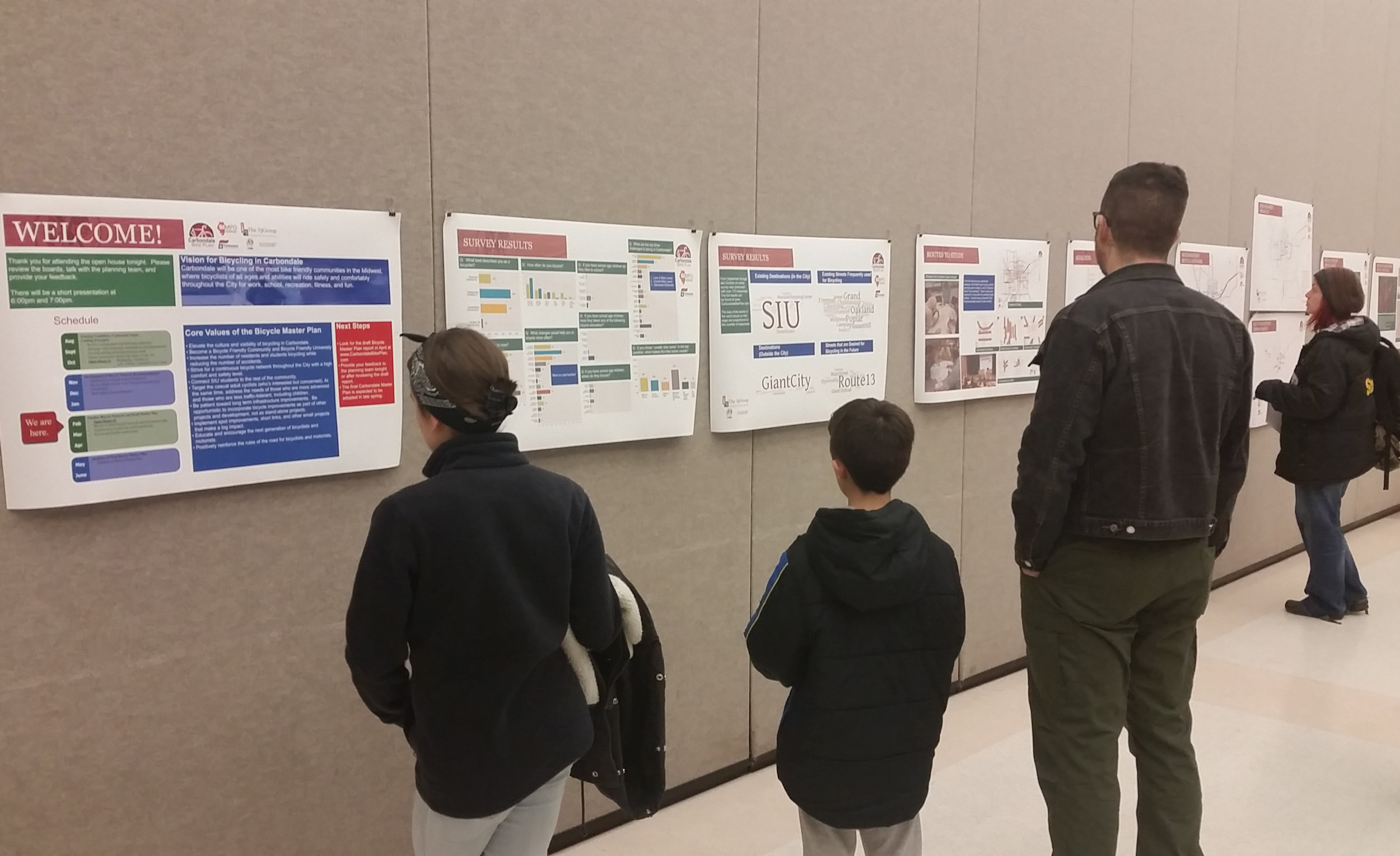 Attendees at the February 17, 2016 Open House review the draft recommendations.