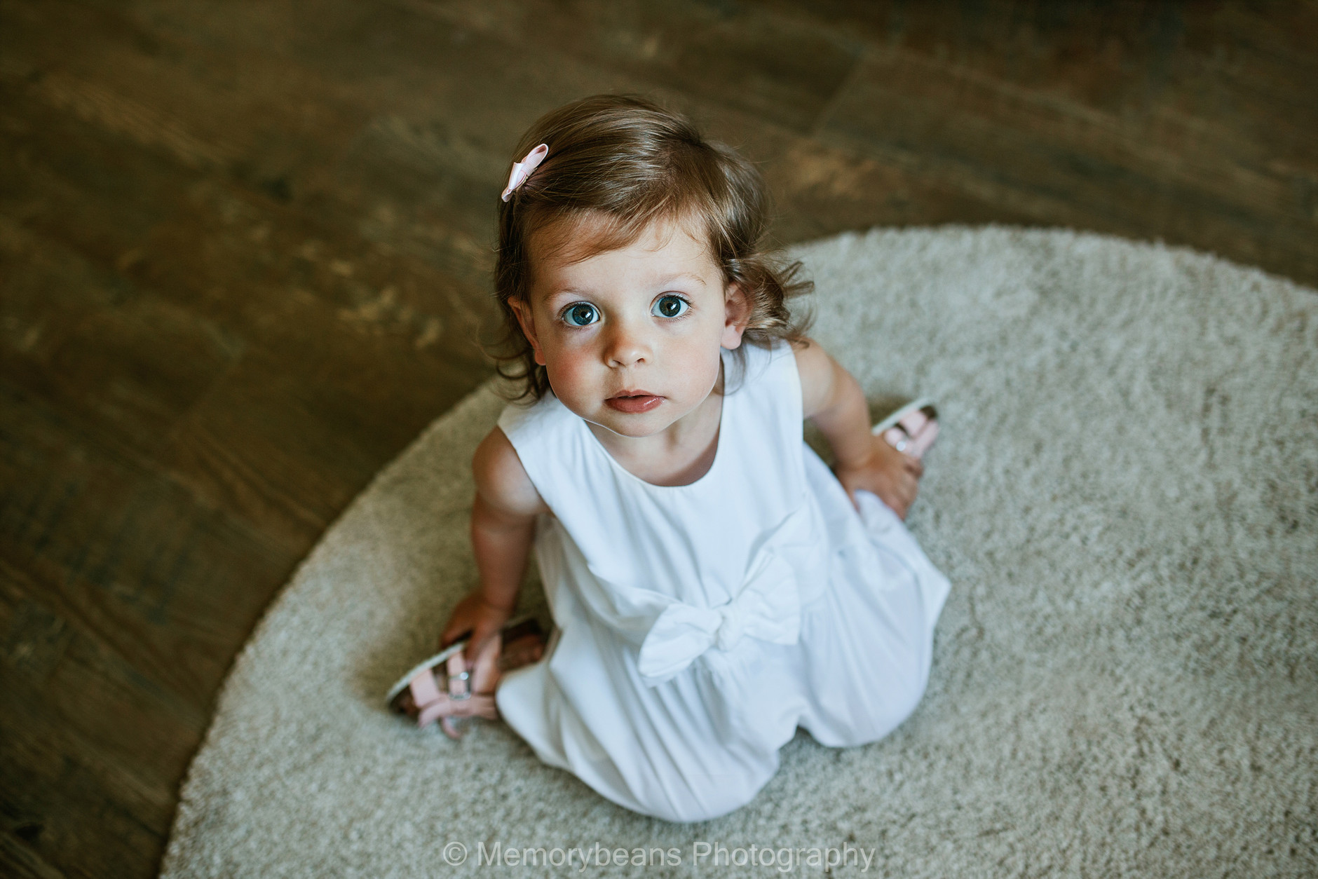 Little girl with big blue eyes looking at the camera