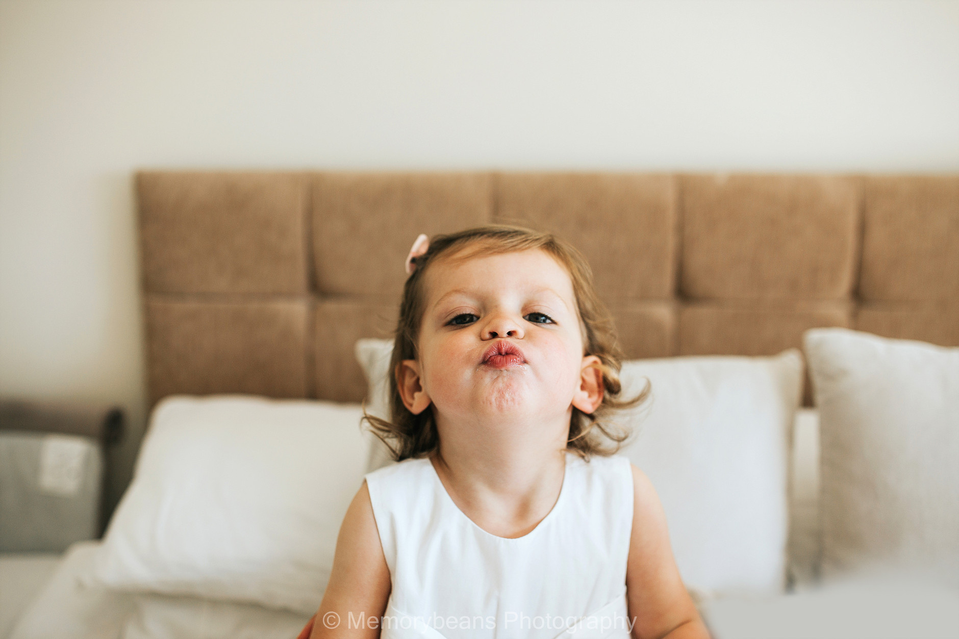 Little girl sending a kiss at the camera