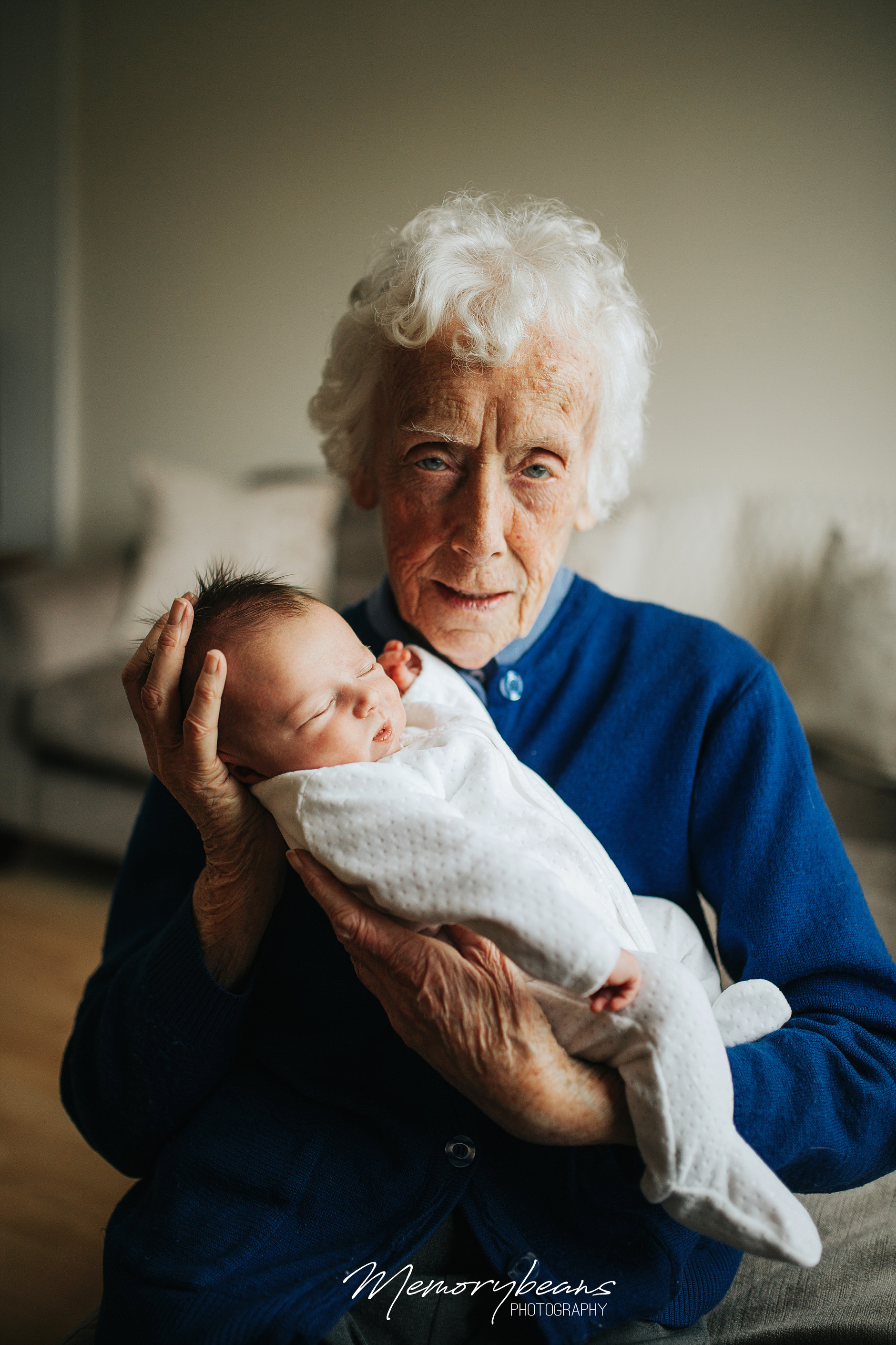 Great grandmother holding newborn baby