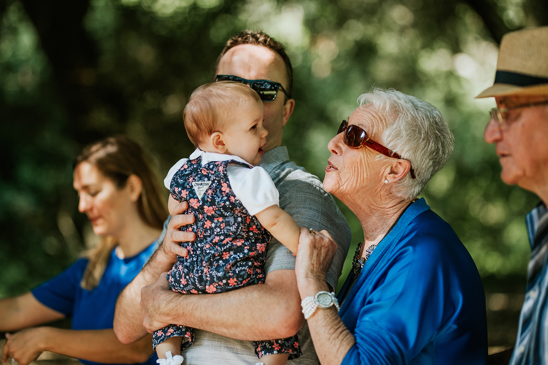 Grandmother making a face at baby girl