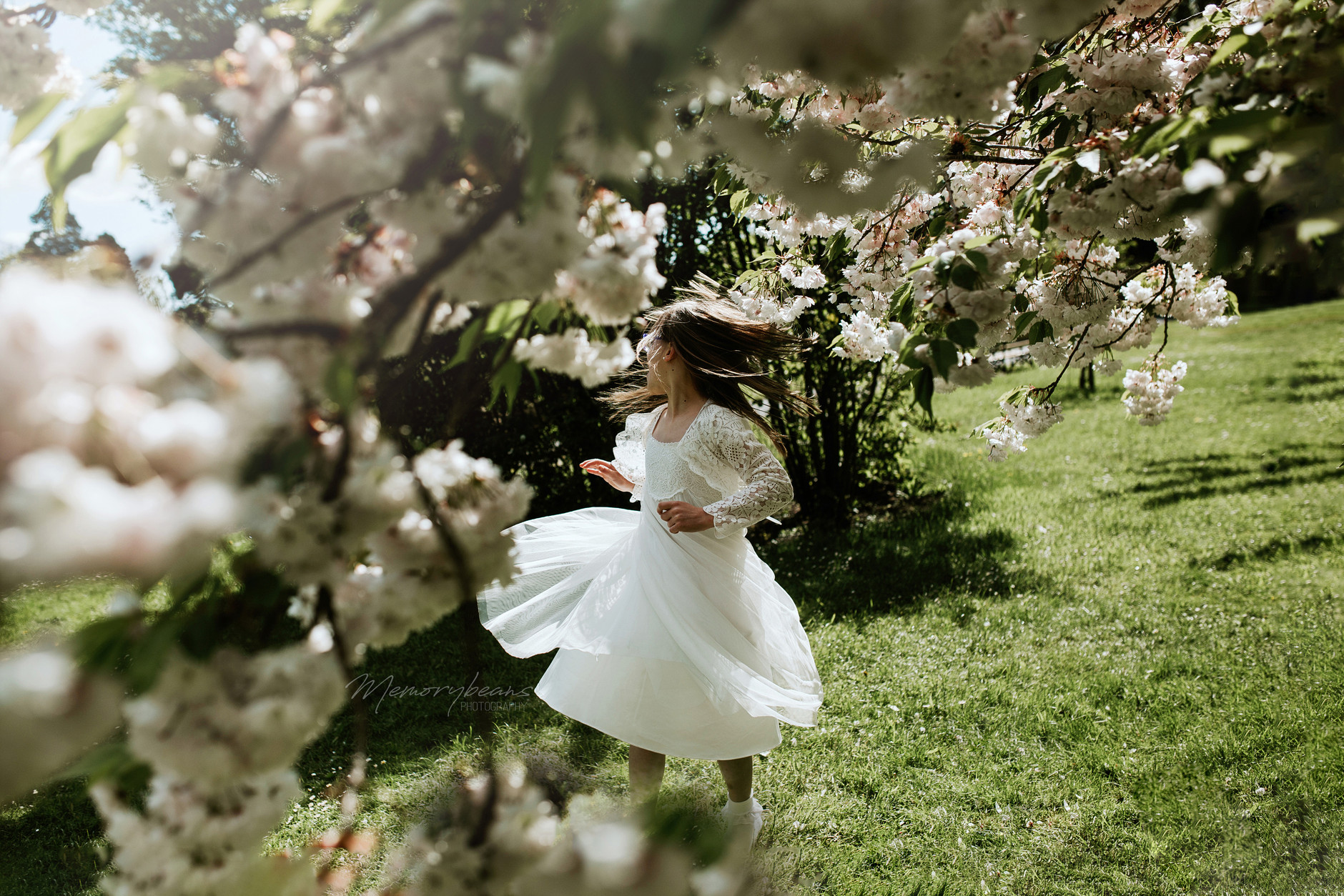 First holy communion daughter twirling her dress in Dublin Botanical Gardens